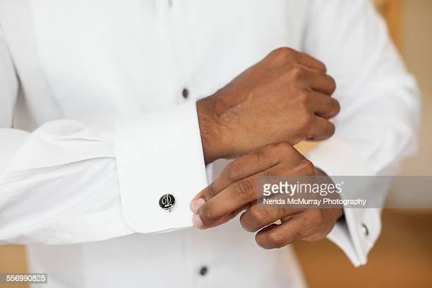 Groom doing up cufflinks