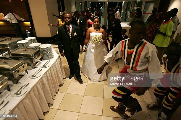 Groom Joshua Muwema and bride Jennifer Mwangi arrive at their wedding on December 3 2005 in Kampala Uganda The Church of Uganda has been very active...