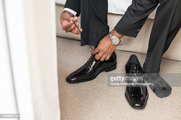 Groom lacing shoes