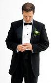 Groom looking at his wedding ring