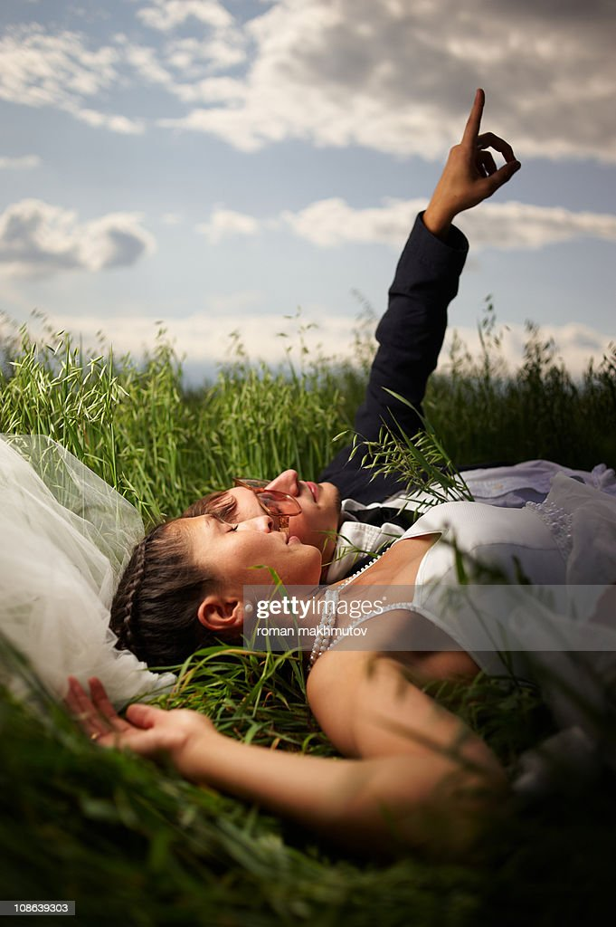 Groom pointing to the sky : Stock Photo