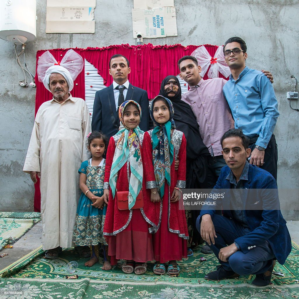 Groom posing with his relatives during a wedding ceremony on December 23, 2015 in Salakh, Qeshm Island, Iran.