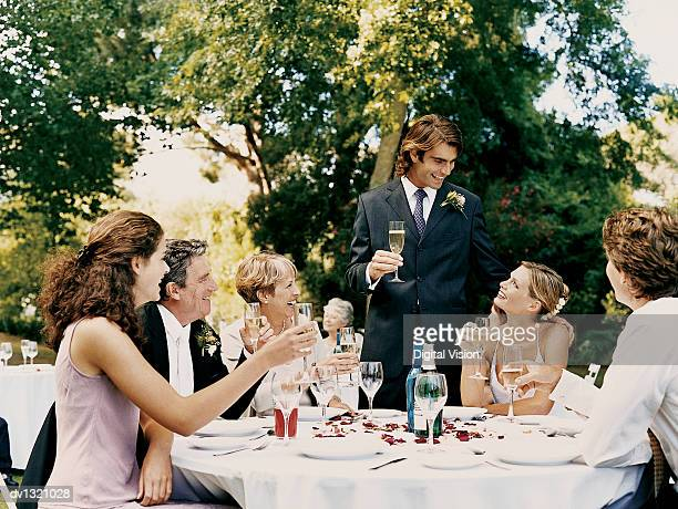 Groom Proposing a toast at a Wedding Reception Held in a Garden
