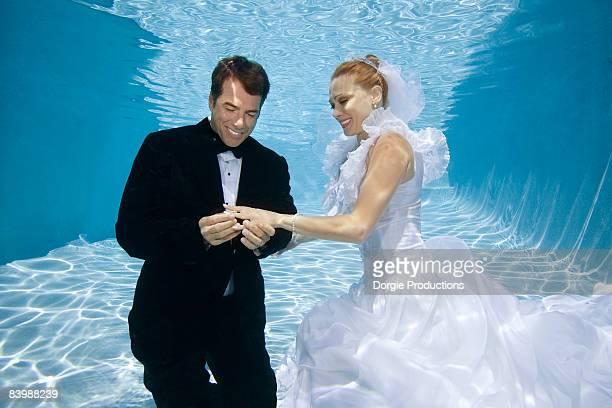 Groom put ring on the bride finger