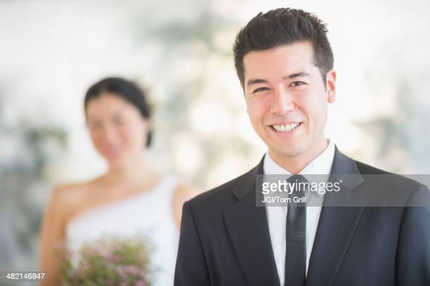 Groom smiling in wedding ceremony