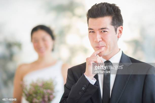 Groom smiling in wedding ceremony