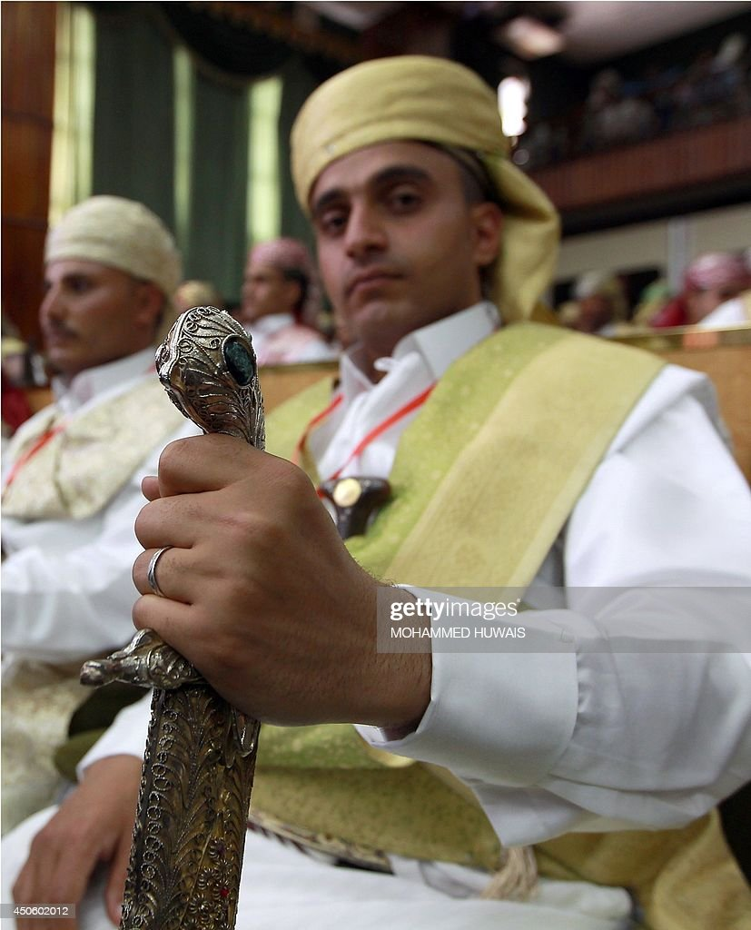 A groom, who is employeed by the Sanaa Municipality, wears a traditional costume and carries a sword, during a mass wedding ceremony on June 14, 2014, in the capital Sanaa. The ceremony was organized by the municipality for 350 members of its staff.