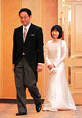 Groom Yoshiki Kuroda and bride Princess Sayako attend a press conference after their wedding ceremony at the Imperial Hotel on November 15 2005 in...