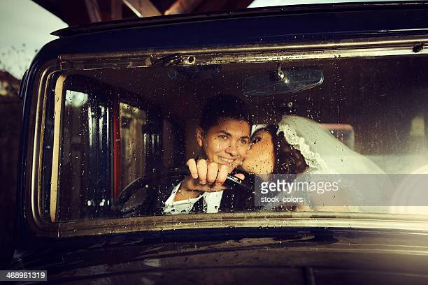grooms in retro car