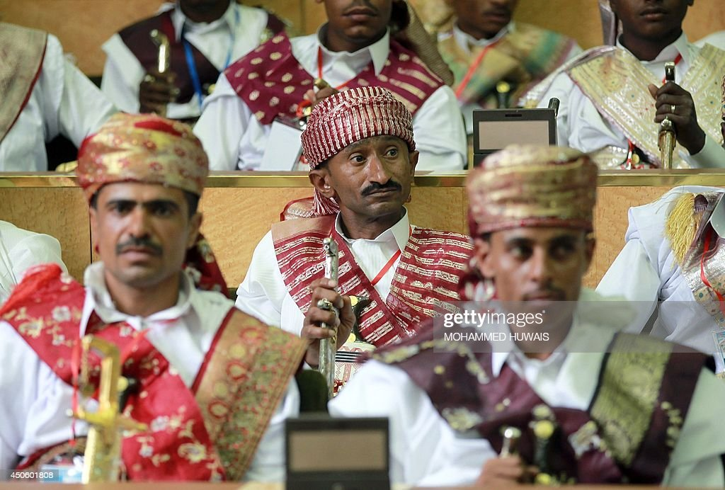 Grooms, who are employees of the Sanaa Municipality, wear traditional costumes and carry swords, during a mass wedding ceremony on June 14, 2014, in the capital Sanaa. The ceremony was organized by the municipality for 350 members of its staff. AFP PHOTO / MOHAMMED HUWAIS