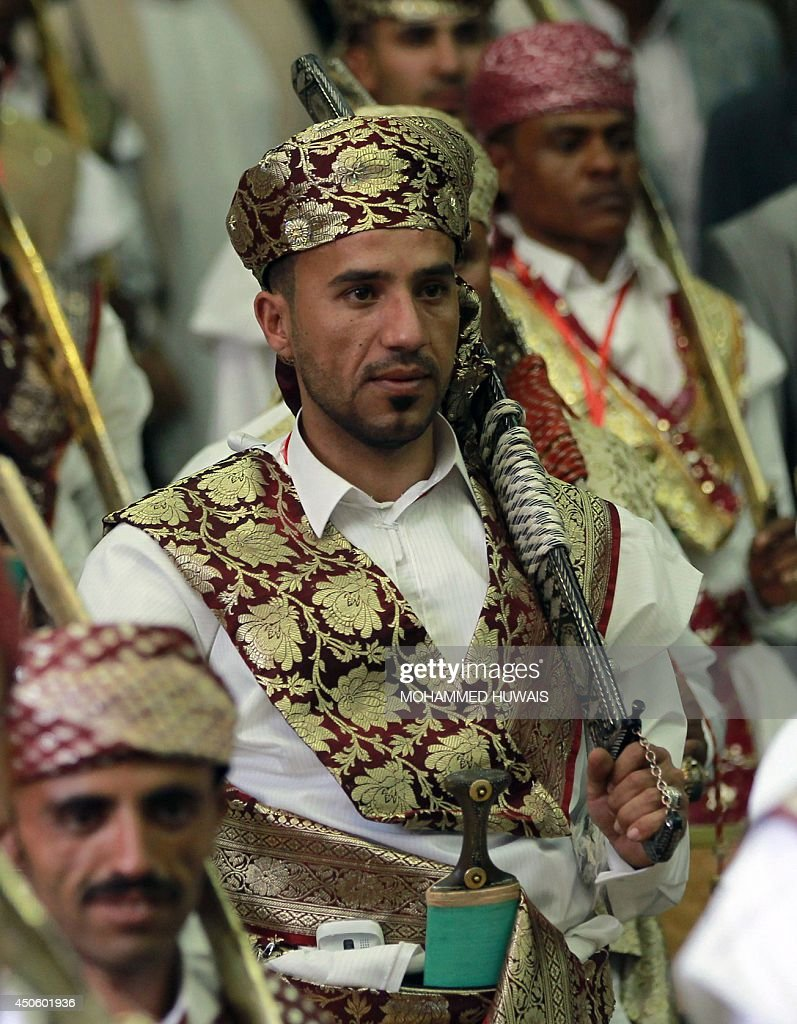 Grooms, who are employees of the Sanaa Municipality, wear traditional costumes and carry swords, during a mass wedding ceremony on June 14, 2014, in the capital Sanaa. The ceremony was organized by the municipality for 350 members of its staff.