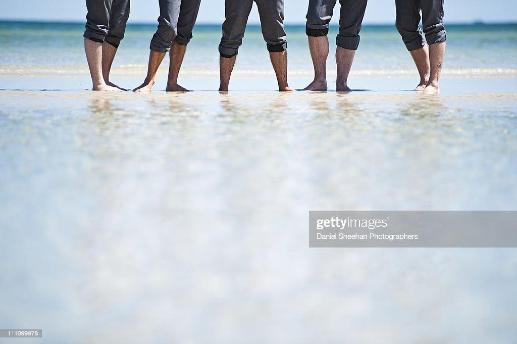 groomsman legs in water : Stock Photo