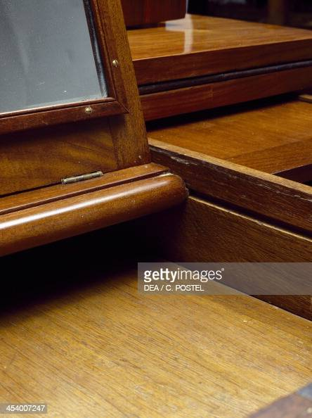 Grooved central compartment detail from a Louis XVI style bonheur du jour with Madagascar rosewood veneer finish and marble top France 18th century