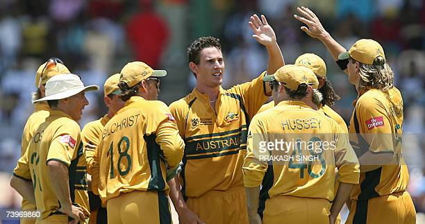 Australian cricketers congratulate bowler Shaun Tait for the wicket of South Africa's Andrew Hall during a semifinal of ICC Cricket World Cup 2007 at...