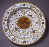Grotesque decorated plate with a country concert in the medallion ceramic Fontana workshop Urbino Marche Italy 16th century Florence Museo Nazionale...