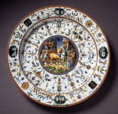 Grotesque decorated plate with the triumph of Caesar depicted in the medallion 15621578 ceramic Fontana workshop Urbino Marche Italy 16th century...