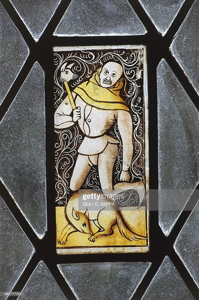 Grotesque figure, detail of a 16th-century stained-glass window, Chateau of Ferrieres, Midi-Pyrenees, France.