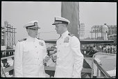 Capt Paul R Schratz USN only surviving member of the crew of the World War II submarine Scorpion presents the Commissioning Pennant of the sub to the...