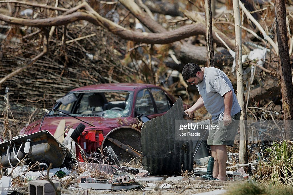 J Grotsma looks for valuables to salvage from what used to be his fatherinlaw's home after it was destroyed during Hurricane Katrina September 6 2005...