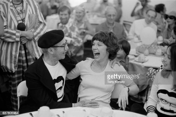 Groucho Marx Shares a Laugh with Girlfriend
