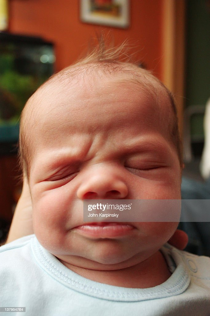 Grouchy baby : Stock Photo