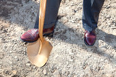 A ground breaking ceremony to kick off new constuction with a gold shovel.