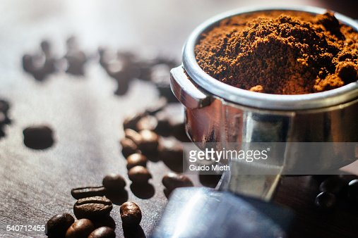 Ground coffee and beans.