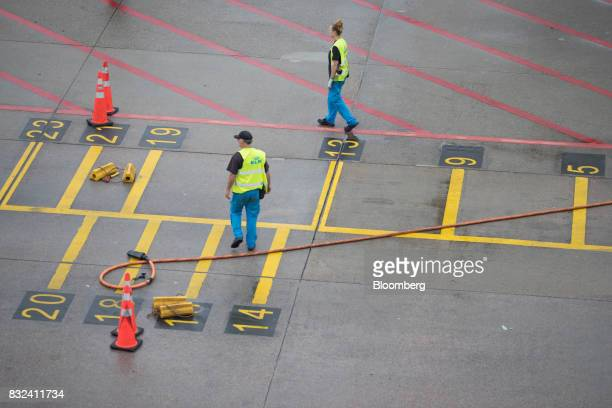 Ground crew await the arrival of a passenger aircraft operated by KLM the Dutch arm of Air FranceKLM Group at Schiphol airport in Amsterdam...