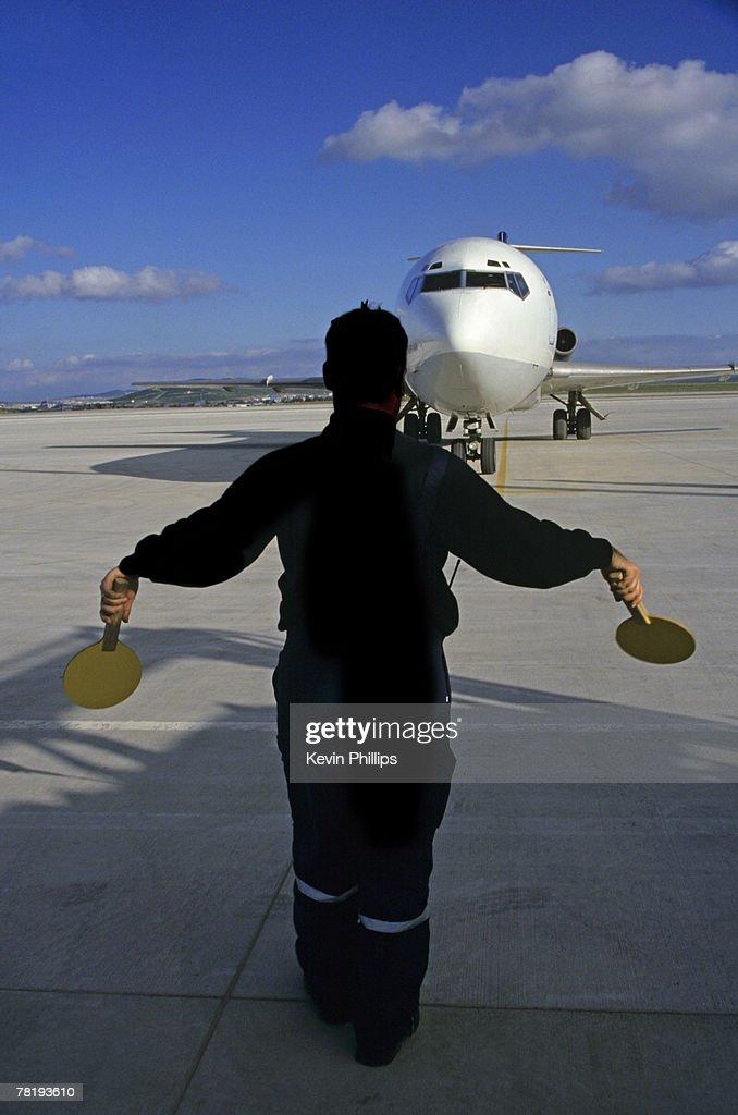 Ground crew directing airplane