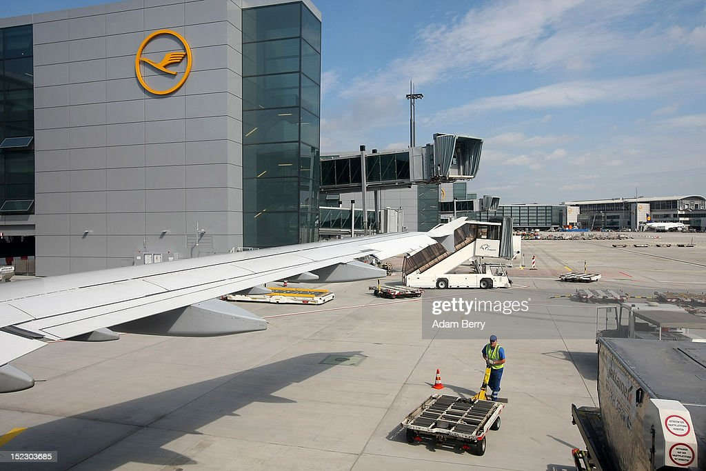 A ground crew employee works in front of the Lufthansa terminal on September 14, 2012 at Frankfurt International Airport (Fraport) in Frankfurt, Germany. After the latest in a series of Lufthansa cabin crew strikes led by the flight attendants' union UFO, actions demanding guarantees for job security as well as a five percent salary increase, resulting in nearly 1,800 flight cancellations after 13 months of contract negotiations, the strikers and the airline have agreed upon a former economic adviser to the German government, Bert Ruerup, as an arbitrator, who has stated that he expects a solution by the end of October. The cabin crew union has agreed not to strike over the estimated six weeks of discussions.