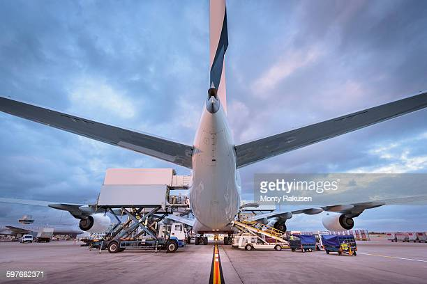 Ground crew loading A380 aircraft at airport