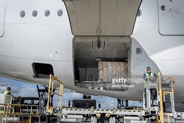 Ground crew loading A380 jet aircraft at airport