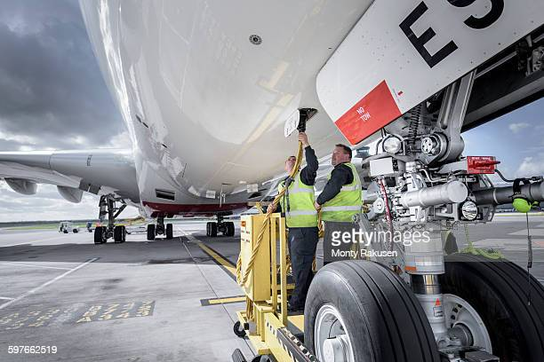 Ground crew operating loading equipment on A380 aircraft