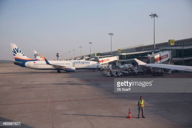 Ground crew prepare clear an aircraft for departure from Adnan Menderes international airport on MAY 20 2014 in Izmir Turkey