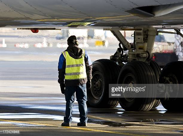 Ground crew preparing big jet for take off