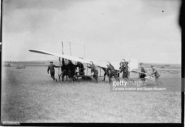 A ground crew pushes a Bleriot XII monoplane Louis Bleriot will fly the plane in the 1909 Grande Semaine de la Champagne