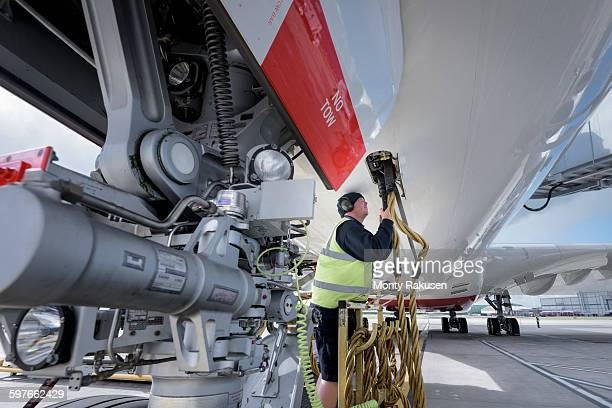 Ground crew service worker with A380 aircraft