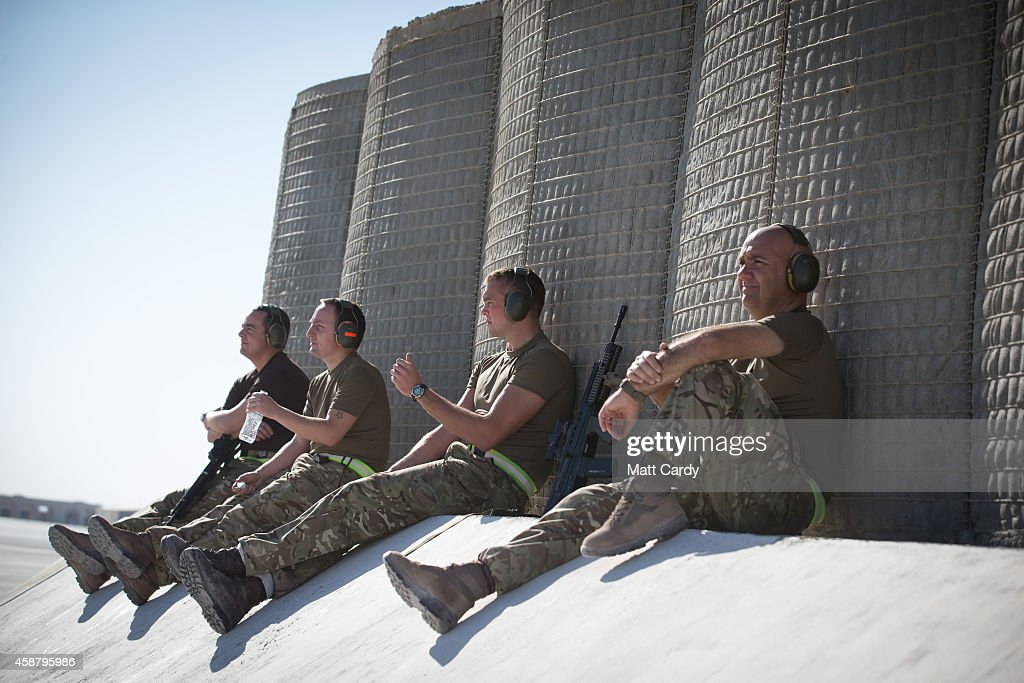 Ground crew watch as a Tornado from RAF Marham's 31 Squadron is prepared for take off from Kandahar airfield completing the Squadron's final...