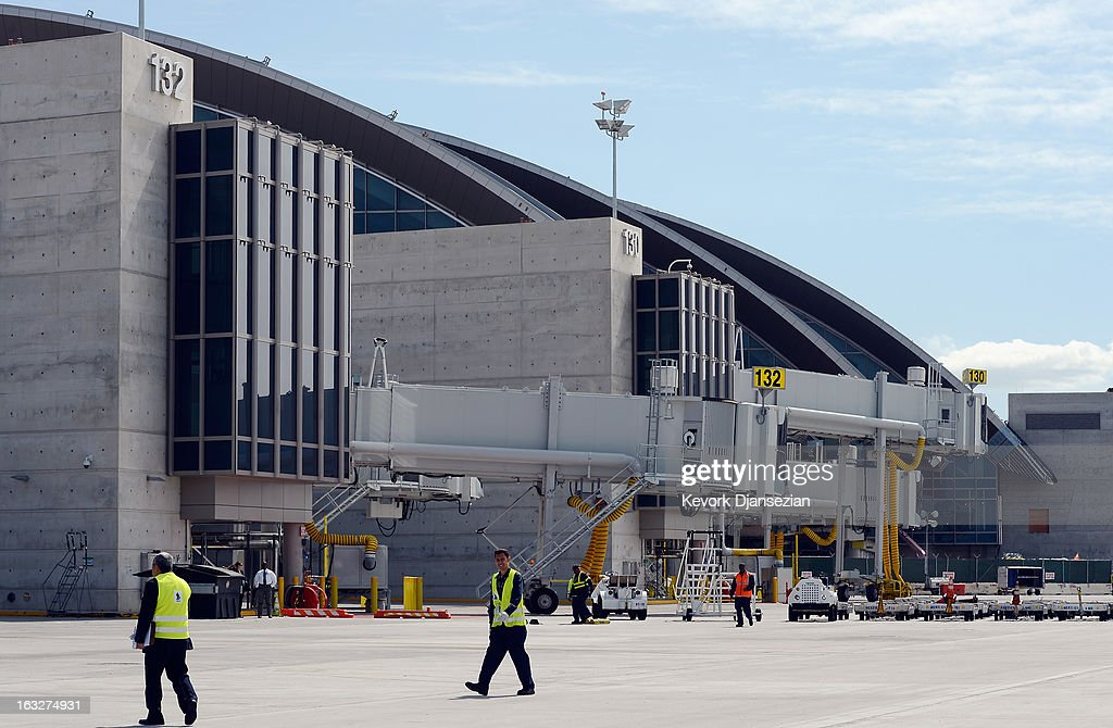 Ground crew work near the new gates of the north concourse during the unveiling of the north concourse and three gates of the new Tom Bradley International Terminal at Los Angeles International Airport on March 6, 2013 in Los Angeles, California. Nine of the new 18 gates, including two of the three unveiled, can accomodate large aircrafts such as the Boeing 747-8 Intercontinental and Airbus A-380 superjumbo jet. LAX is currently undergoing a $4.1 billion airport modernization program.