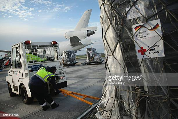 A ground crew worker prepares to load a plane with a 25ton shipment of tents generators airconditioning units chlorine for disinfection and other...