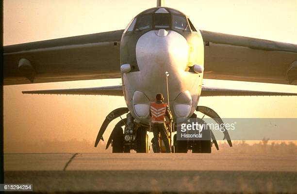 A ground crewman prepares a B52H Stratofortress aircraft for takeoff during exercise Glad Customer '82 Darwin Australia November 1 1982
