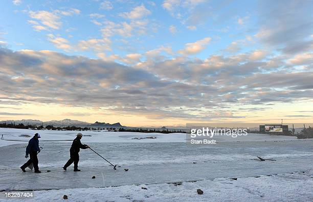 Ground crews remove snow on the driving range at sunrise before the restart of the first round of the World Golf ChampionshipsAccenture Match Play...