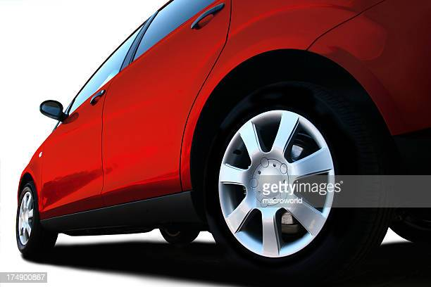 A ground level shot of the back wheel of a car
