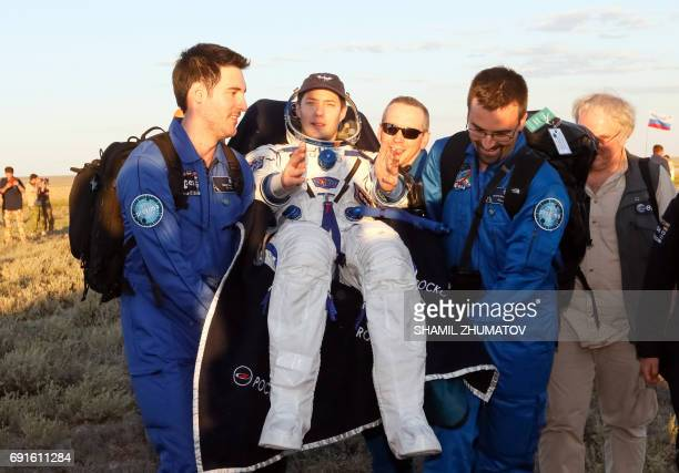Ground personnel carry French astronaut Thomas Pesquet after landing in a remote area outside the town of Dzhezkazgan Kazakhstan on June 2 2017 A...