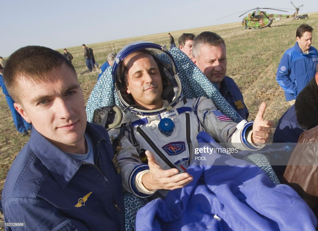 Ground personnel carry International Space Station (ISS) crew member US astronaut Joseph Acaba shortly after his landing near the town of Arkalyk in northern Kazakhstan, on September 17, 2012. A woman took today command of the ISS for only the second time as three US and Russian colleagues made a safe return from the orbiting space lab to the Kazakh steppe.