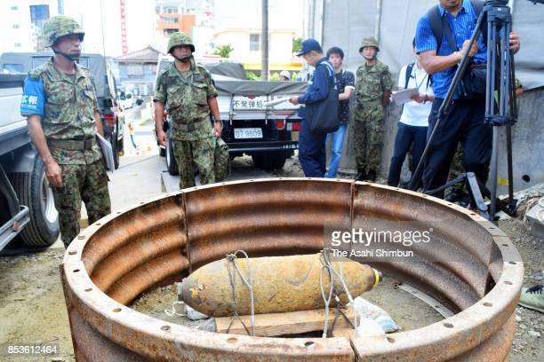 Ground SelfDefense Force member remove a defused US bomb on September 23 2017 in Naha Okinawa Japan A renowned tourist destination here was emptied...