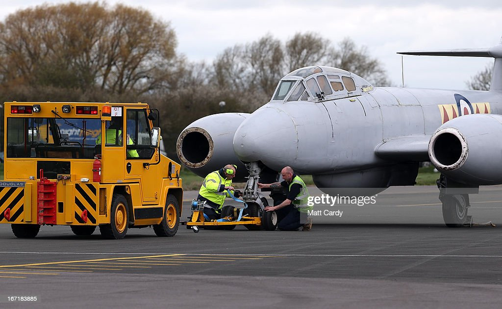 Ground staff attend to a Gloster Meteor T.7 jet after it was moved to its new home at the Jet Age Museum which is based at Gloucestershire Airport in Staverton by a RAF Chinock on April 22, 2013 near Gloucester, England. The 1949 aircraft was moved the short distance from RAF Innsworth as the base has now closed and the Meteor's future was uncertain. It will now join a growing collection of aircraft at the new museum.