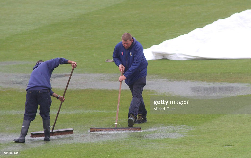 Ground staff clear away water before the England Nets session ahead of the 2nd Investec Test match between England and Sri Lanka at Emirates Durham ICG on May 26, 2016 in Chester-le-Street, United Kingdom.