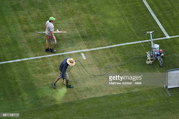 Ground staff paint the grass green prior to the International Champions Cup 2015 match between Club America and Manchester United at CenturyLink...