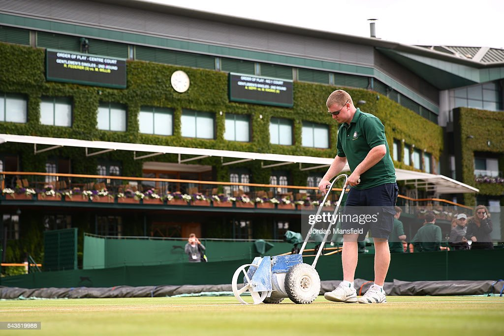 Ground staff prepare the courts prior to day three of the Wimbledon Lawn Tennis Championships at the All England Lawn Tennis and Croquet Club on June 29, 2016 in London, England.